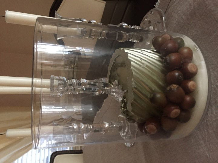 Acorns in a candle holder