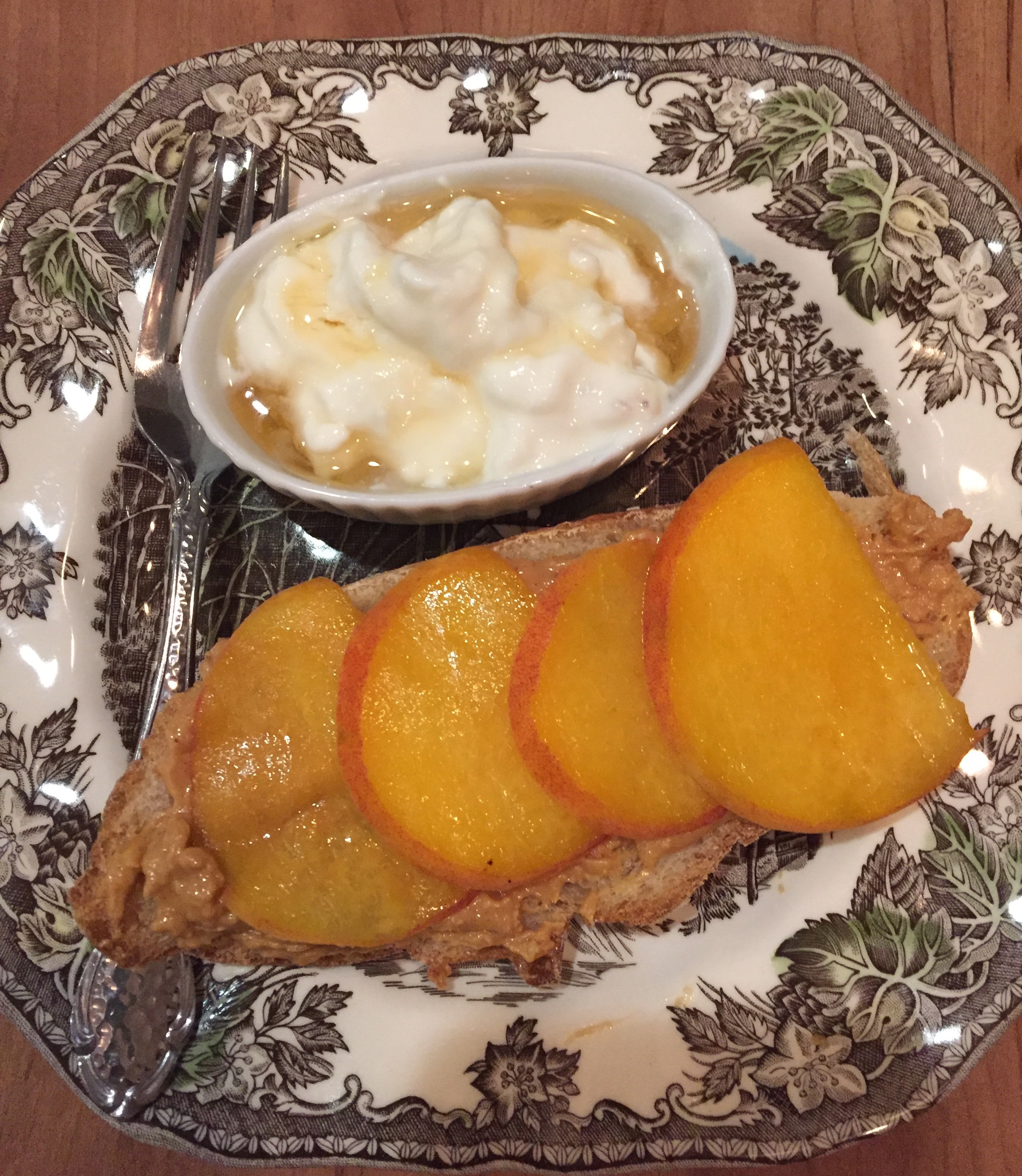 Yogurt peanut butter on toast with peaches breakfast