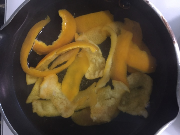 Orange rinds in boiling water