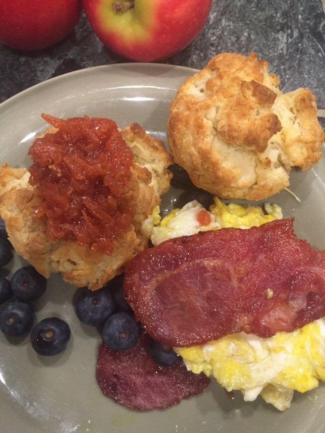 Biscuit scrambled eggs quince jam turkey bacon
