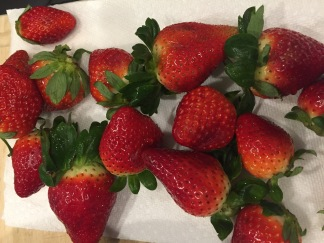 Wash and dry all the strawberries