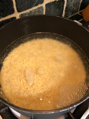 Orzo cooking in boiling salted water